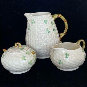 Belleek Pottery  pitcher, creamer and sugar bowl.